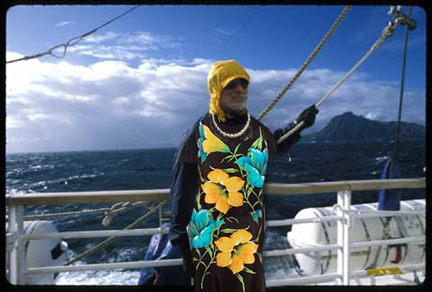 Un-retiouched photo of ancient mariner in lovely British lady flower-print dress to ward off mal de mer.  The pearls were a nice nautical touch, dontcha think? Photo by S. Walls, © 1998, UrbisMedia