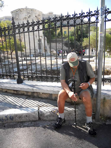 A man mourns loss of a taverna beside the agora and Temple of the Four Winds.