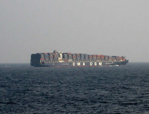 The chariots of globalism; container ship in the Andaman Sea © 2011, UrbisMedia