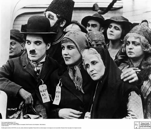 Chaplin comforts fellow nervous immigrants prior to disembarkation. The Immigrant, Mutual Pictures, 1917