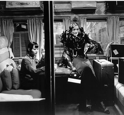 Anna May Wong and Marlene Dietrich ride in separate compartments on the Shanghai Express. ©1932 Paramount Pictures